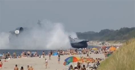 Russia Kaliningrad Hovercraft Lands on Crowded Beach | The